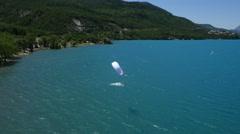 Aerial of surfer kitesurfing in sea - stock footage
