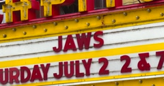 Movie Theater Marquee - Vintage - Neon - Jaws - Zoom Out - 4K Stock Footage