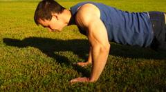 Caucasian fitness man training push ups - stock footage