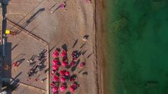 Jaz beach with sunbathing people. Top view. Budva municipality, Montenegro Stock Footage