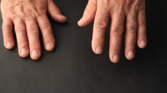 Senior man with finger tremors Stock Footage