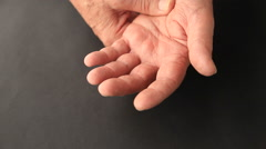 Older man has finger tremors Stock Footage