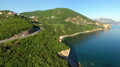 Adriatic highway passing around hills. Cars driving on road. Budva Stock Footage