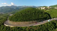 Traffic on the asphalt road on the hill near coastline of Jaz beach, Budva Stock Footage