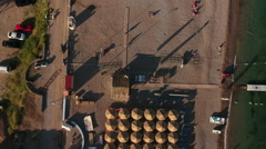Top view at the Jaz beach with people laying on sunbeds under parasols on sand Stock Footage