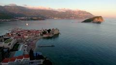 Evening Budva city and Sveti Nikola (St. Nicolas) island in Adriatic. Montenegro Stock Footage