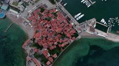 Sea port of Budva next to medieval old town. Adriatic sea, aerial. Montenegro Stock Footage