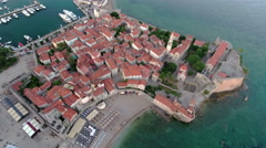 Aerial view at area of medieval old town of Budva with Mogren beach. Montenegro Stock Footage