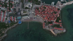 Flying over medieval old town, sea port and center of Budva, Montenegro Stock Footage