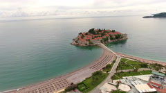 Sveti Stefan city shoreline and narrow isthmus connecting with islet. Montenegro Stock Footage