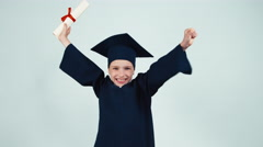 Happy graduate child has diploma on white - stock footage