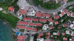 Coastal highway passing on hills of Budva through dwelling houses. Montenegro Stock Footage