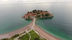 Narrow isthmus connecting luxury beaches with Sveti Stefan islet. Montenegro Stock Footage