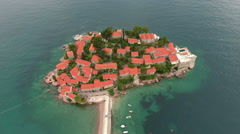 Sveti Stefan island. Aerial view at the red roofs of village houses. Montenegro Stock Footage