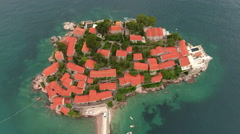 Sveti Stefan islet. Luxury hotel with red roofs. Montenegro Stock Footage