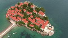 Flying around Sveti Stefan islet, Adriatic sea, Montenegro Stock Footage