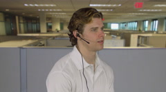 Professional male talks to customer in an office Stock Footage