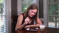 4K Woman Eats Chocolate Cake - stock footage