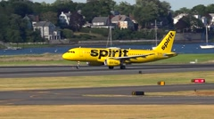 Spirit Airlines yellow plane takes off Stock Footage