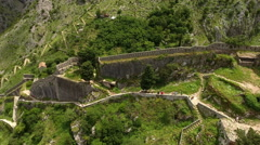 Many stony stairs leading to highest point of hill the castle St. John. Kotor Stock Footage
