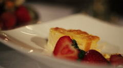 Person take piece of dessert cake with fruits by fork in restaurant. Dinner Stock Footage