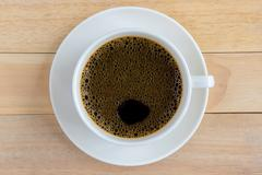 Cup of coffee on wood background. Stock Photos