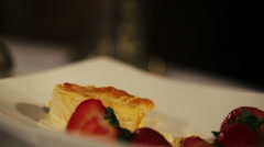 Woman take piece of dessert with strawberry by fork in restaurant. Dinner Stock Footage