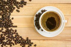 Cup of coffee on wood background. - stock photo