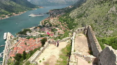 Tourists stand on the high point of castle St. John (San Giovanni). Montenegro Stock Footage