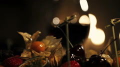Woman take cherry from plate with fruits in restaurant. Dinner. Romantic Stock Footage