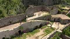 Tourists walk on the fortifications of castle St. John (San Giovanni). Kotor Stock Footage