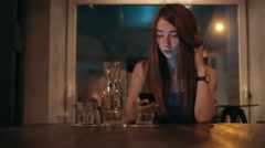 Young woman using cell phone to type text message or communicate Stock Footage
