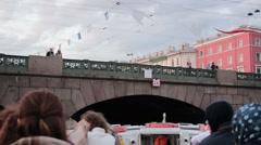 Tourists On The Pleasure Boat Swim Under The Bridge - stock footage
