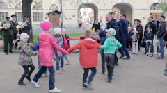 Happy Children Round Dancing Under The Sounds Of A Military March Stock Footage