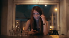 Happy young woman using cell phone to type text message or communicate Stock Footage