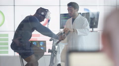 4KAthlete in scientific research program being tested by scientist in white coat Stock Footage