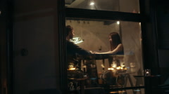Happy Young Woman feeding her boyfriend in cafe - Ouside shot Stock Footage