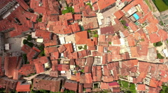 Red roofs of houses in medieval town of Kotor city, camera rotates. Montenegro Stock Footage