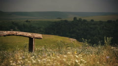 Panorama of summer field in mountains covered by greenery. Landscape. Fence Stock Footage