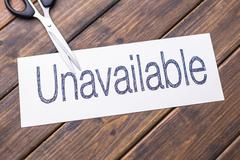 Unavailable to available by scissors Stock Photos