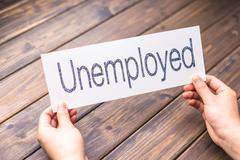 Unemployed to employed on white paper Stock Photos