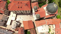 People walk on square next to Serbian Orthodox church of St. Nicholas. Montenegr Stock Footage