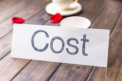 Cost on white paper in cafe Stock Photos
