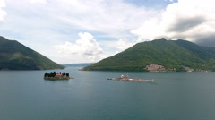 Gospa od Skrpjela and Sveti Dordje. Adriatic sea. Montenegro Stock Footage