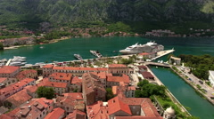 Flying to the port of Kotor with moored cruise liners, Aerial view from old town Stock Footage
