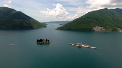 Aerial view of Boka Kotorska (gulf of Kotor) with two islands Gospa od Skrpjela Stock Footage