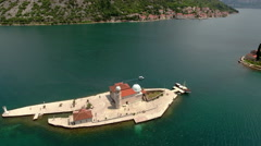 Tourist popular place in Adriatic sea is an artificial island Gospa od Skrpjela Stock Footage