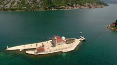 People walking on artificial island Gospa od Skrpjela, Perast, Montenegro Stock Footage