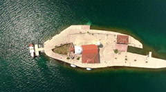 Top view at artificial island Gospa od Skrpjela on coast of Perast in Kotor Bay Stock Footage