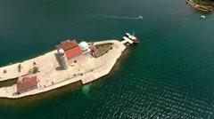 Aerial view at artificial island Gospa od Skrpjela. Kotor Bay. Montenegro Stock Footage